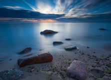 Rocky sea shore at sunrise. Beautiful seascape Stock Photo