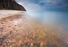 Rocky sea shore at sunrise. Beautiful seascape Royalty Free Stock Photos