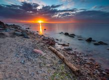 Rocky sea shore at sunrise. Beautiful seascape Stock Photos