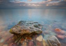 Rocky sea shore at sunrise. Beautiful seascape Royalty Free Stock Images