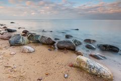 Rocky sea shore at sunrise. Beautiful seascape Stock Images