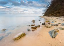 Rocky sea shore at sunrise. Beautiful seascape Royalty Free Stock Photos