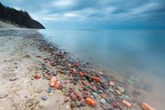 Rocky sea shore at sunrise. Beautiful seascape Royalty Free Stock Photo