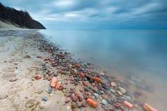 Rocky sea shore at sunrise. Beautiful seascape Royalty Free Stock Photo