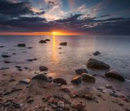 Rocky sea shore at sunrise. Beautiful seascape Royalty Free Stock Image