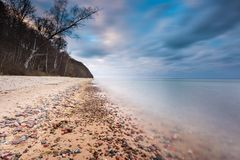 Rocky sea shore at sunrise. Beautiful seascape Stock Image