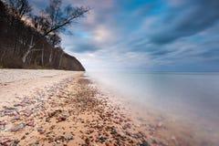 Rocky sea shore at sunrise. Beautiful seascape Stock Image