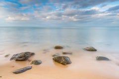 Rocky sea shore at sunrise. Beautiful seascape Stock Photos