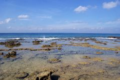 The rocky sea shores at Laxmanpur Beach, Neil Island. The blue sea and the rock shores at Laxmanpur Beach, Neil Islands in Andamans Royalty Free Stock Photography