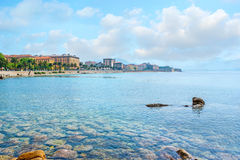The rocky seabed. The pure waters expose the rocky seabed at the Ajaccio coast with the old town buildings on the background, Corsica, France Royalty Free Stock Photo