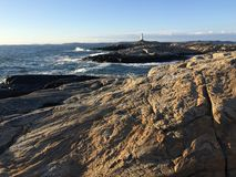 Rocky seacoast with lighthouse Royalty Free Stock Photography