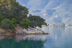 Rocky seacoast. With pine trees, Poros island, Greece Stock Images