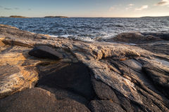 Rocky seacoast on sunrise. landscape Stock Photos