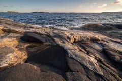 Rocky seacoast on sunrise. landscape Stock Photos