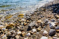 Rocky shore with shallow turquoise sea created by water erosion Stock Images