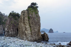 Rocky seascape. Huge rocks formation shoreline with scenic pine trees on the cliff top on Izu Peninsula in Japan stock photo