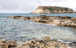 Rocky Seascape with the island of  geronisos Royalty Free Stock Images