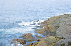 Rocky Seashore of Cape Spear. Dangerous rocky seashore of Cape Spear, Newfoundland, the eastern most point of North America Royalty Free Stock Photo