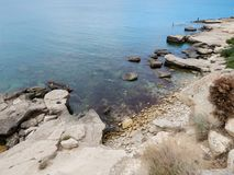 Rocky seashore of the Caspian Sea. Rocky shore of the Caspian Sea. View from above. Kazakhstan royalty free stock photo
