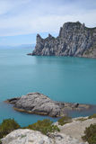 Rocky seashore. Clean sea and blue sky Royalty Free Stock Photos