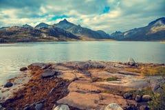 Rocky seashore with cloudy sky royalty free stock photos