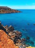 Rocky seashore at Ghajn Tuffieha, Malta. Cinematic style Stock Photography