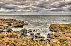 Rocky seashore in Portstewart Stock Image
