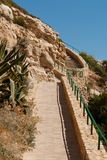 Rocky seashore. Stone staircase on the mountainside. Picturesque sea landscape. Summer seascape. Spain Stock Photography
