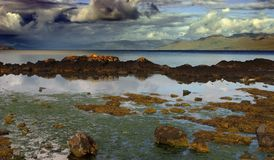 Rocky Seashore of Scotland in Stormy Weather Stock Images