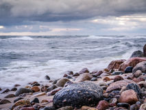Rocky seashore with stormy sea Royalty Free Stock Images