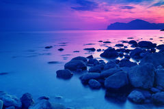 Rocky seashore before sunrise. Early morning, wilderness, beautiful nature Royalty Free Stock Photos