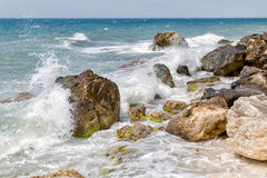 Rocky seashore during surf Stock Photo