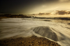 Rocky seashore with warm color tones Royalty Free Stock Photo
