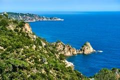 Rocky seaside of Cala Salionc Stock Photos