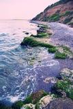 Rocky seaside at dusk Stock Photo
