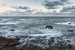 Rocky seaside, during the wind and storm stock photography