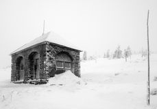 Rocky Shelter in Snow Covered by Hoarfrost Royalty Free Stock Photography
