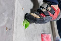 Free Rocky Shoe On A Tiny, Scanty Snare Stands With The Tip Of The Sock In Close-up On The Climbing Wall In The Room Royalty Free Stock Photography - 147258417