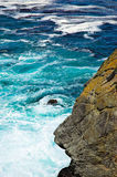 Rocky Shore. Deep blue and aquamarine water on a rocky Pacific shore stock images