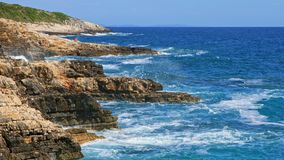 Rocky shore of the Adriatic sea after storm stock video footage