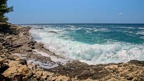 Rocky shore of the Adriatic sea after storm slow motion from 120fps stock video footage