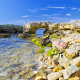 Rocky shore against a blue sky Royalty Free Stock Image