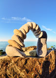 Rocky Shore. Arch of pebbles on the rocky seashore Royalty Free Stock Photo