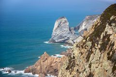 Rocky shore of the Atlantic Ocean coast, Portugal Stock Images