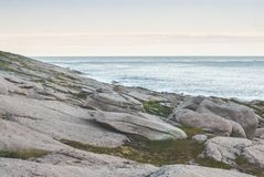 A rocky shore of the Barents Sea, the island of Mageroya, Norway Royalty Free Stock Photos