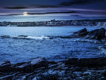 Rocky shore and a beach of Black sea at night. SOZOPOL, BULGARIA - SEPTEMBER 11, 2013: rocky shore and sandy city beach in mellow season. Beautiful and warm stock images