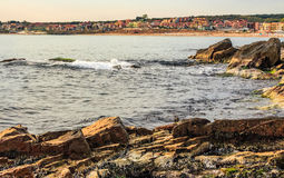 Rocky shore and a beach of Black sea. SOZOPOL, BULGARIA - SEPTEMBER 11, 2013: rocky shore and sandy city beach in mellow season. Beautiful and warm weather on royalty free stock images