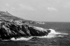 A Rocky Shore in Black and White. In the area known as Lapsi in Malta Stock Image