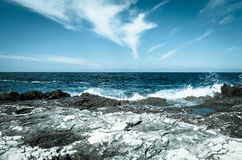 Rocky shore and blue sea Stock Photos