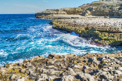 Rocky shore and blue water in Sardinia Stock Image